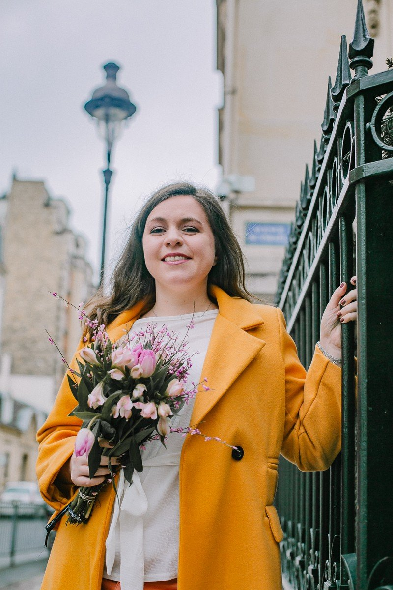 Cliona Byrne holding a bouquet of flowers in Paris